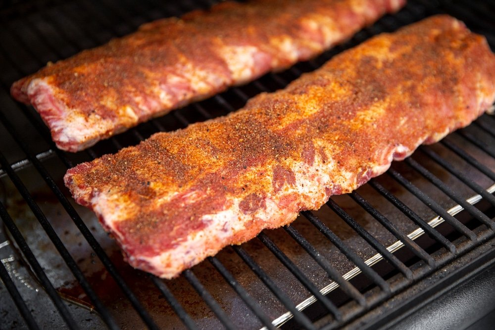 Baby back ribs on a smoker.