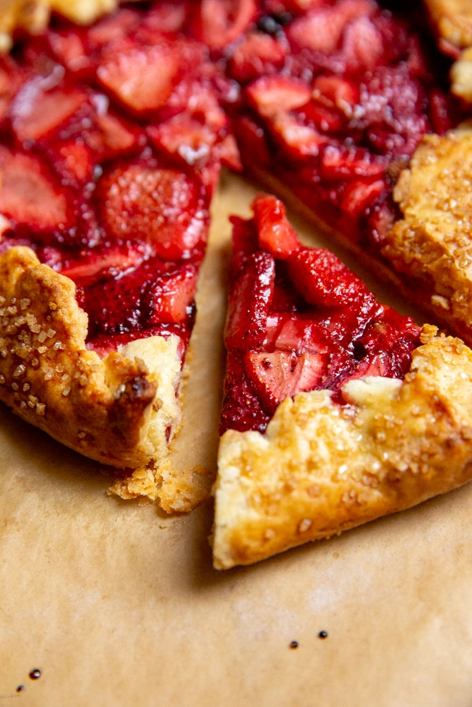 Close up of a slice of strawberry galette with gluten free crust.