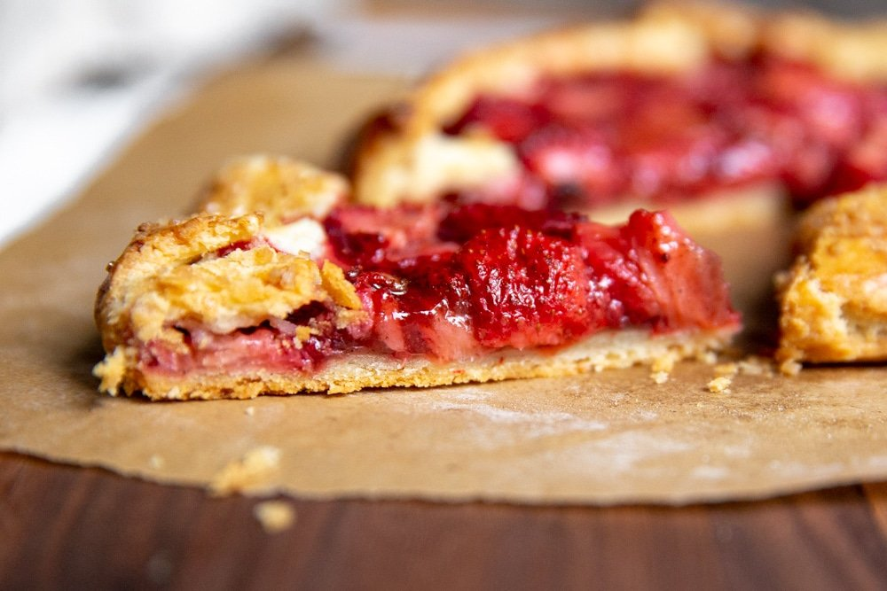 Side angle shot of a slice of strawberry galette.
