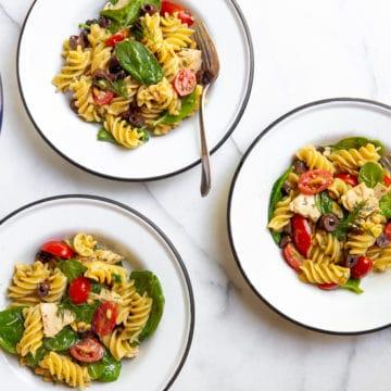 Bowls of tuna pasta salad on a countertop.