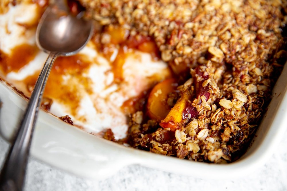 Close up of the baked peach crisp topping.