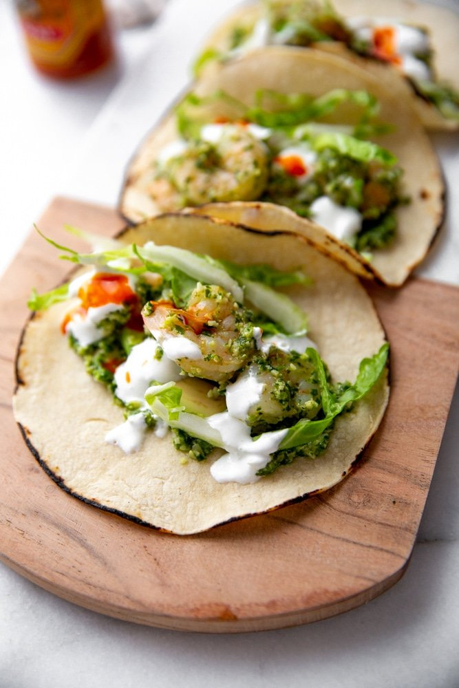 Close up of healthy shrimp tacos on a serving board.