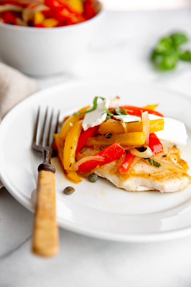 Slow roasted peppers piled over a seared chicken breast.