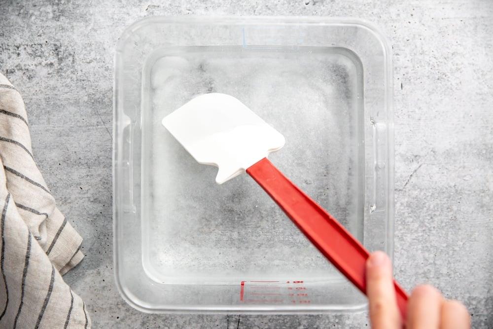 Process shot showing hand mixing brine ingredients.