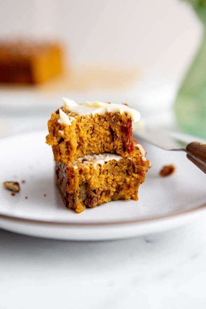 Pumpkin bread stacked on a plate.