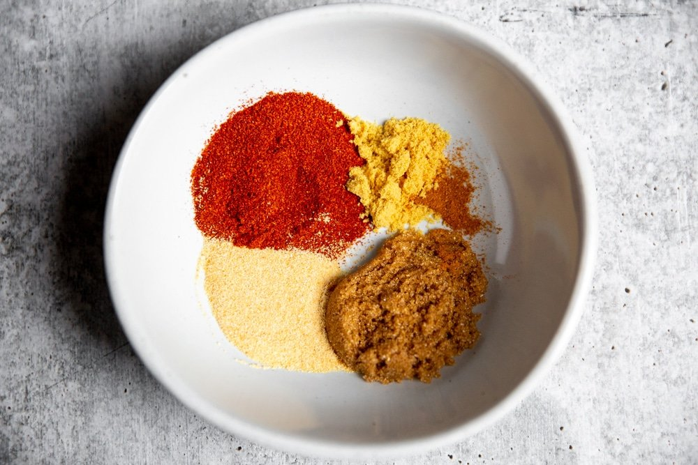 Spices for the pork spice rub in a small bowl.