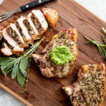 Traeger grilled pork chops on a serving board.