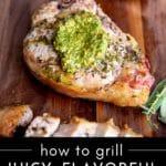 Grilled pork chops on a serving board.