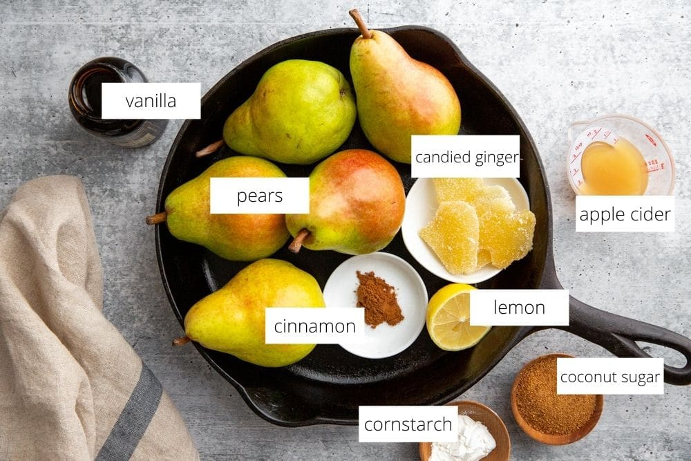 All of the ingredients for the pear crumble filling arranged on a countertop.