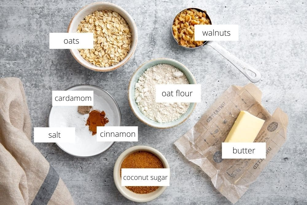 All of the ingredients for the pear crumble topping recipe, arranged on a countertop.