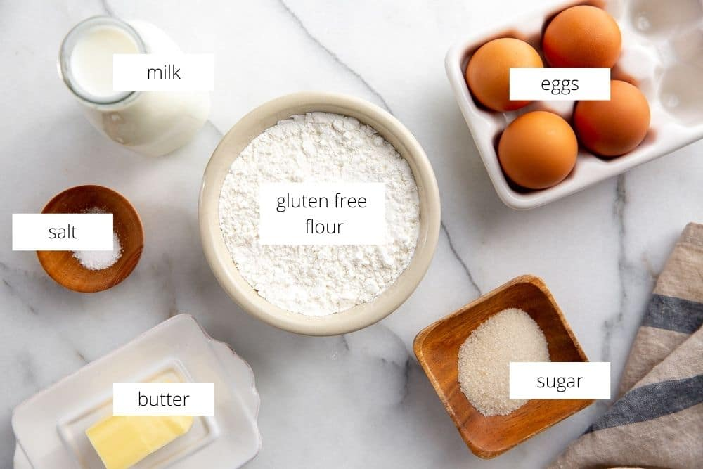 The gluten free crepe recipe ingredients arranged on a marble surface.