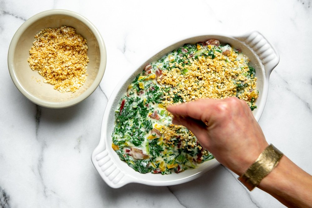 The baked Swiss chard gratin on a marble surface.