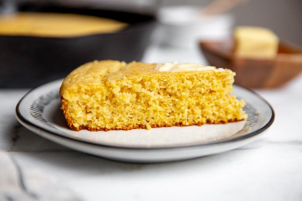 A slice of cornbread on a plate.