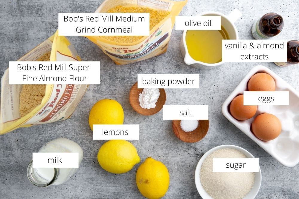 All of the ingredients for the lemon olive oil polenta cake recipe arranged on a work surface.