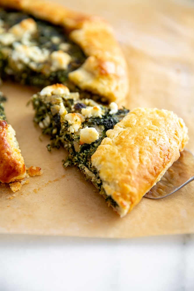 Close up of a slice of spinach tart.