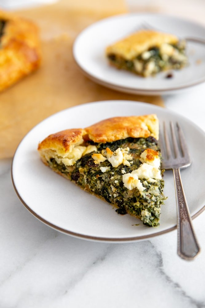 A slice of the savory pie on a plate with a fork.