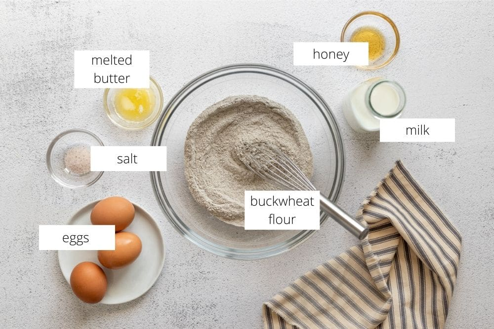 All of the ingredients for the buckwheat crepes recipe arranged on a work surface.