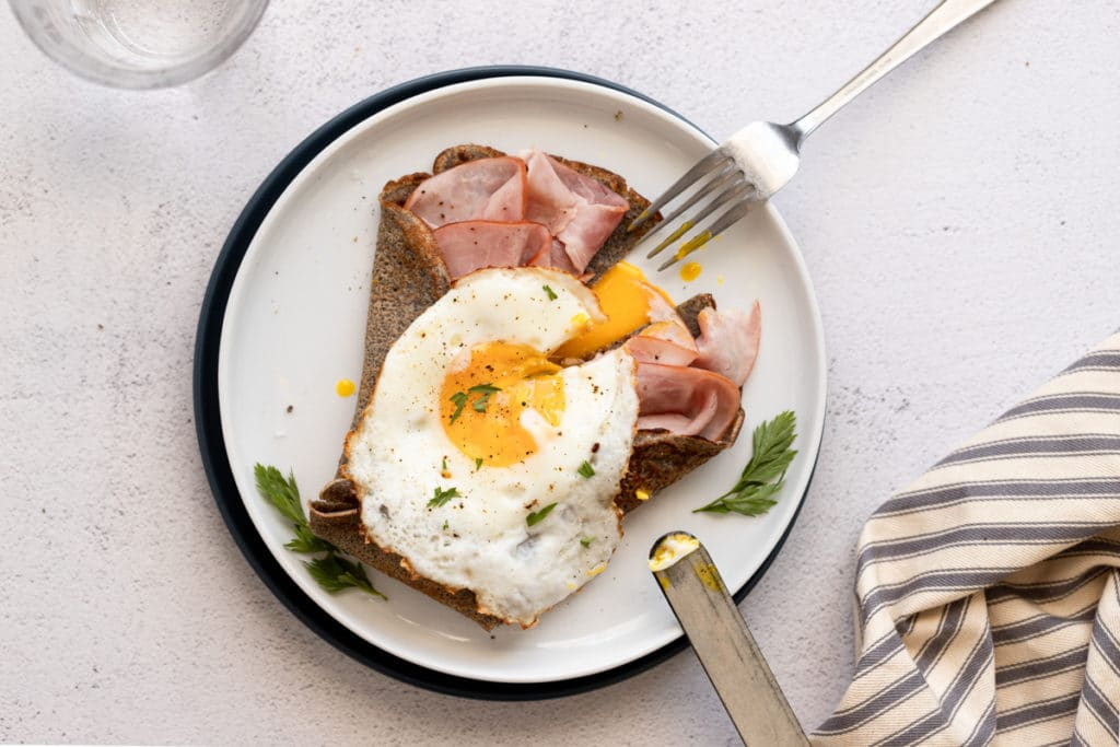 Buckwheat crepe filled with ham and topped with a fried egg.