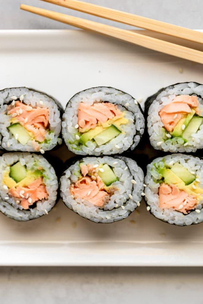 Close up of salmon sushi rolls.