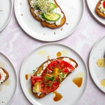 Sweet and savory cottage cheese toasts on plates.