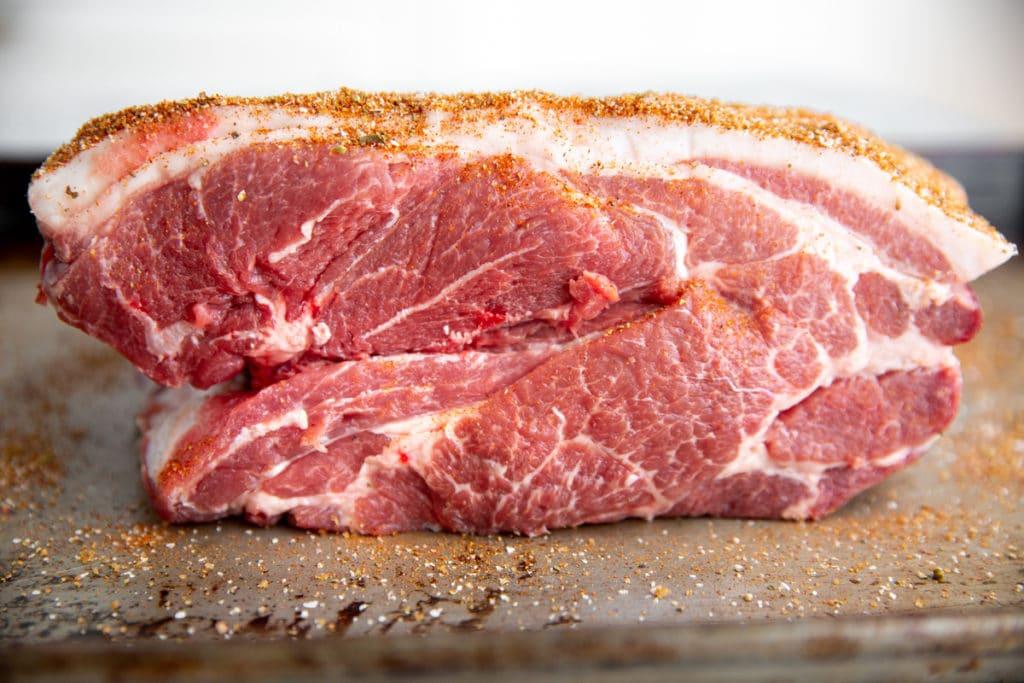 A boneless pork butt on a sheet pan.