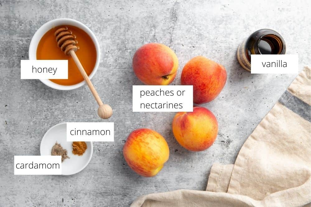 All of the ingredients for the grilled peaches recipe arranged on a work surface and labeled.