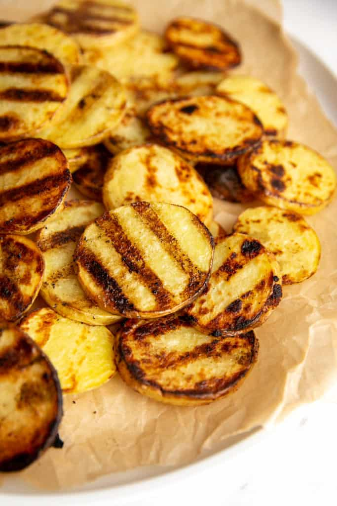 Grilled Yukon gold potatoes on a sheet of parchment paper.