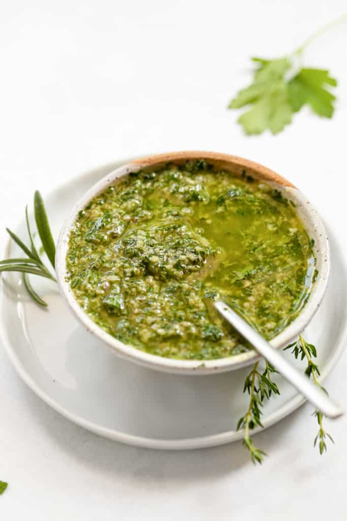 A bowl of Italian salsa verde with a spoon.