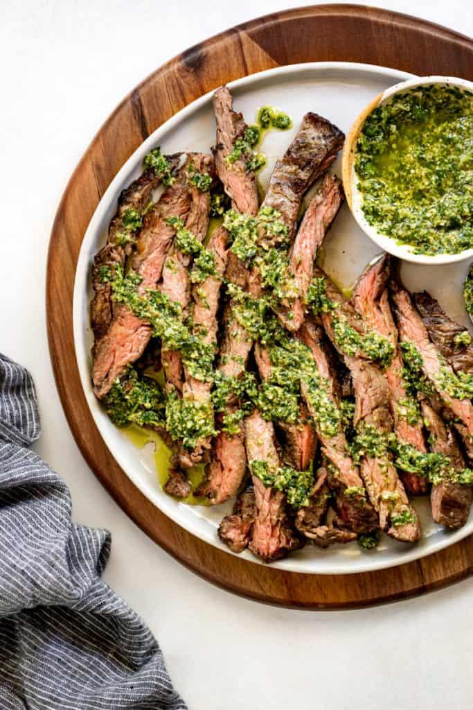 Italian salsa verde drizzled over sliced skirt steak.