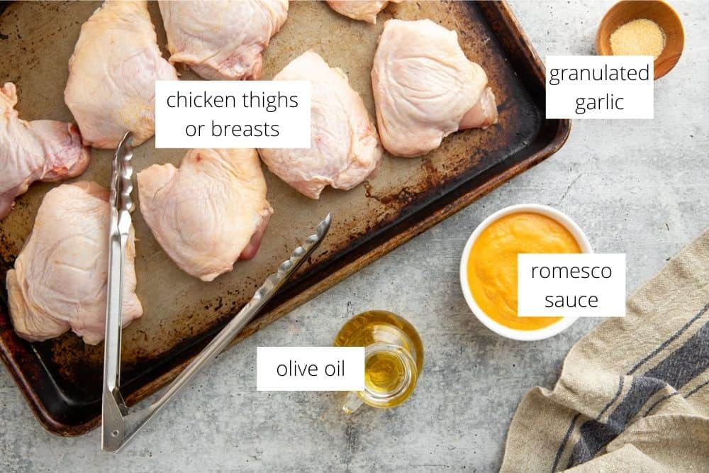 The ingredients for the romesco chicken recipe on a work surface with labels.