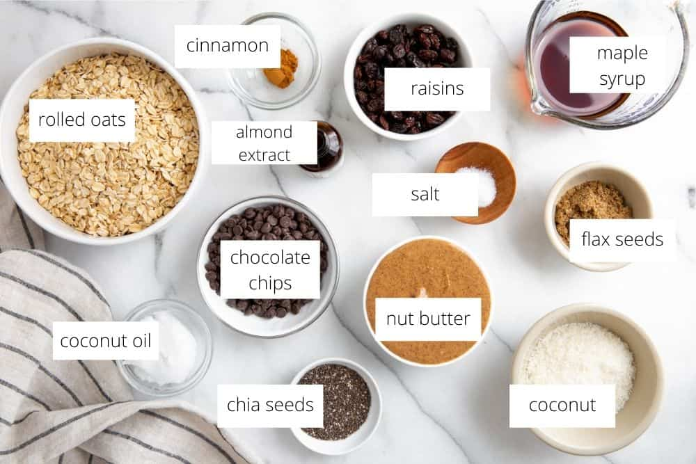 All of the ingredients for the no bake cookies recipe arranged on a marble surface with labels.