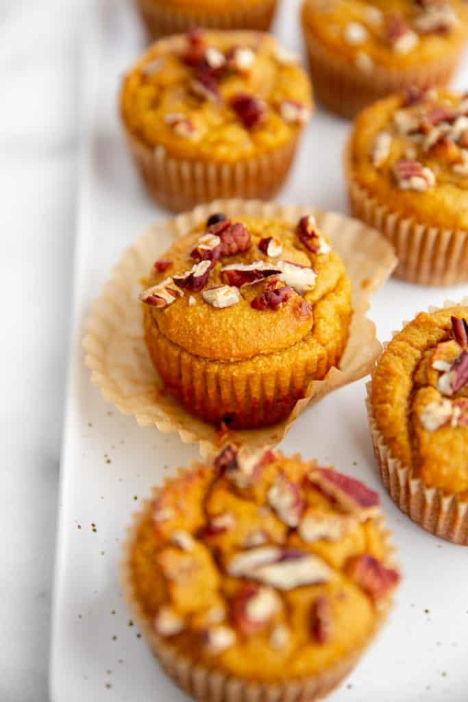 Gluten free pumpkin muffins on a platter.