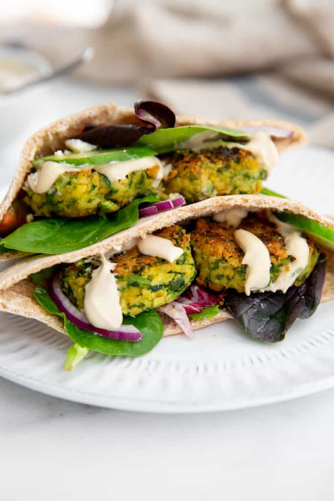Pan fried falafel in pita bread with lettuce, onion, cucumbers and tahini sauce.