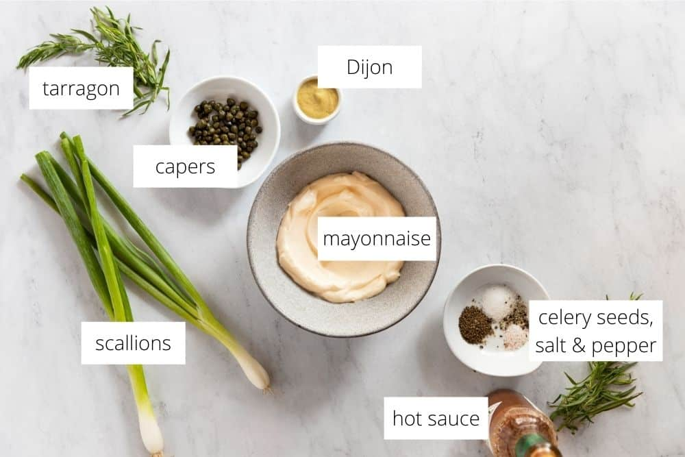 All of the ingredients for the tarragon aioli recipe arranged on a work surface with labels.